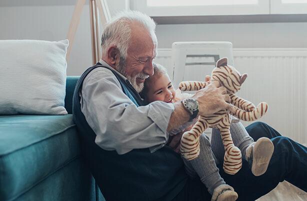Senior home care client spending quality time with grandchildren.